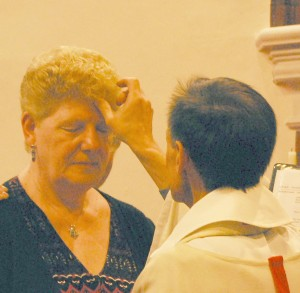 Fr Raglan anointing Sheila Hichisson