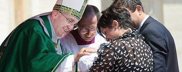 Pope Francis blesses a baby