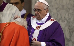A Cardinal is sprinkled with ashes by Pope Francis during the Ash Wednesday mass at the Santa Sabina Basilica in Rome